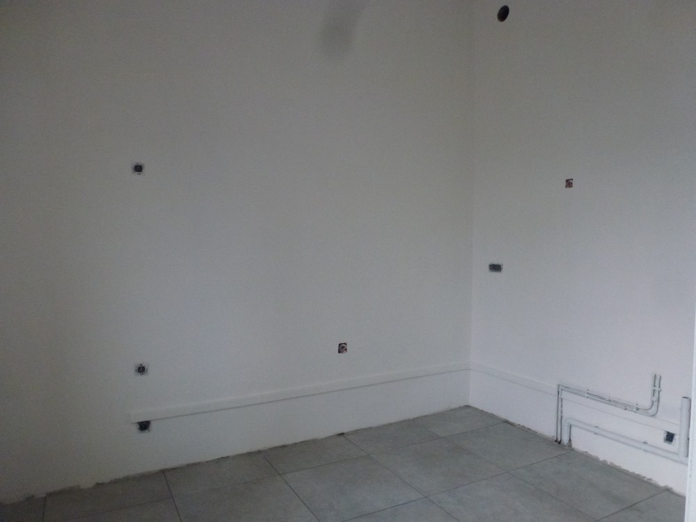 Chambery-rénovation-d-appartement-traitement-platre-cuisine-travail-termine